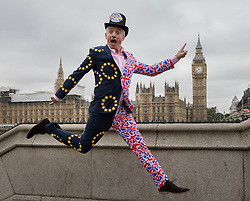 "© Licensed to London News Pictures. 22/06/2016. London, UK. Ryanair's CEO, Michael O'Leary, leaps in the air wearing a Union and EU flag suit as he calls for a big ""Remain"" vote in the EU Referendum. The last day of campaigning for the EU referendum is taking place today. Photo credit: Peter Macdiarmid/LNP"