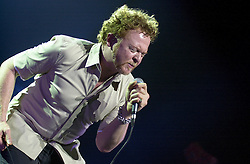 Mick Hucknall/Simply Red live at Sheffields Hallam FM Arena during their 2003 &quot;Home&quot; Tour<br /> Michael James &quot;Mick&quot; Hucknall (born 8 June 1960) is an English pop singer and songwriter. Formerly the lead singer of the modestly successful punk rock band the Frantic Elevators, Hucknall achieved international fame in the 1980s as the lead singer and songwriter of the soul-influenced pop band Simply Red. They sold more than 50 million albums over a 25-year career. Their style drew upon influences ranging from blue-eyed soul, New Romantic and rock to reggae and jazz<br /> <br /> Copyright Paul David Drabble<br /> 03 May 2003