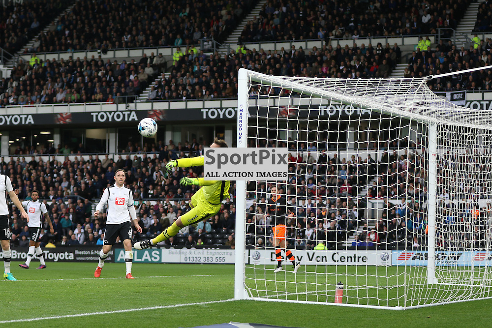 DERBY, UNITED KINGDOM 29 OCTOBER 2016:   Derby County goalkeeper Scott Carson saves during the league game between Derby County and Sheffield Wednesday in the Football League Championship at Pride Park Stadium, on October 29, 2016 in Derby, England. (Photo by Michael Poole)