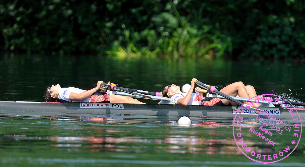 (BOW) MAGDALENA KEMNITZ & (STROKE) AGNIESZKA RENC (BOTH POLAND) REST AFTER THE WOMEN'S LIGHTWEIGHT DOUBLE SCULLS FINAL A DURING REGATTA ROWING WORLD CUP ON ROTSEE LAKE IN LUCERN, SWITZERLAND...SWITZERLAND , LUCERN , JULY 11, 2010..( PHOTO BY ADAM NURKIEWICZ / MEDIASPORT )..PICTURE ALSO AVAIBLE IN RAW OR TIFF FORMAT ON SPECIAL REQUEST.