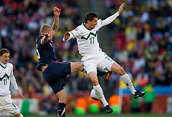 Jay DeMerit of USA vs Andraz Kirm of Slovenia during the 2010 FIFA World Cup South Africa Group C match between Slovenia and USA at Ellis Park Stadium on June 18, 2010 in Johannesberg, South Africa. (Photo by Vid Ponikvar / Sportida)