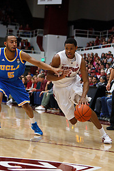 Dec 29, 2011; Stanford CA, USA;  Stanford Cardinal guard/forward Anthony Brown (3) dribbles past UCLA Bruins guard Jerime Anderson (5) during the first half at Maples Pavilion.  Stanford defeated UCLA 60-59. Mandatory Credit: Jason O. Watson-US PRESSWIRE