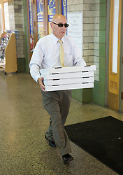 BALTIMORE, MD - Saturday, July 28, 2012: Pizzas carried to the Tottenham Hotspur train as the team head for New York after a pre-season friendly match against Liverpool at the M&T Bank Stadium. (Pic by David Rawcliffe/Propaganda)