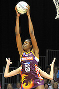 Romelda Aiken secures the incoming pass for the Firebirds ~ Netball action from ANZ Championship Grand Final - Queensland Firebirds v Northern Mystics - played at the Brisbane Convention Centre on Sunday 22nd May 2011 ~ Photo : Steven Hight (AURA Images) / Photosport