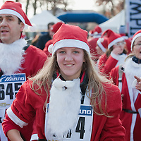 NOALE, ITALY - DECEMBER 18:  One of the participants  dressed as Father Christmas smiles as she take part in the Noale Santa Run on December 18, 2011 in Noale, Italy. Close to two thousand people participated in the third annual Noale Santa Run, one of the largest non competitive Santa Run in Italy.
