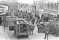 Police supported by the army halt a People's Democracy march in English Street, Armagh, N Ireland, UK. PD supporters were addressed by Tomas MacGiolla, president of Official Sinn Fein, and Bernadette Devlin, the independent Mid-Ulster MP. 197302250098b.<br /> <br /> Copyright Image from Victor Patterson, 54 Dorchester Park, Belfast, UK, BT9 6RJ<br /> <br /> t1: +44 28 9066 1296 (from Rep of Ireland 048 9066 1296)<br /> t2: +44 28 9002 2446 (from Rep of Ireland 048 9002 2446)<br /> m: +44 7802 353836<br /> <br /> e1: victorpatterson@me.com<br /> e2: victorpatterson@gmail.com<br /> <br /> The use of my copyright images is subject to my Terms & Conditions.<br /> <br /> It is IMPORTANT that you familiarise yourself with them. They are available on my website at www.victorpatterson.com.<br /> <br /> None of my copyright images may be used on a website unless they are visibly watermarked, i.e. © Victor Patterson within the body of the visible image. Metadata denoting my copyright must NOT be deleted. <br /> <br /> Web use (maximum size - 300 kb) is extra at currently recommended NUJ rates.