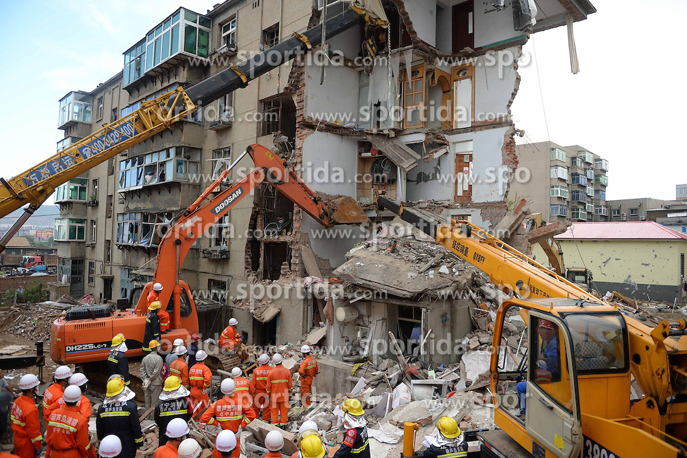 Rescuers work at the accident scene where an explosion took place in Huludao City, northeast China's Liaoning Province, June 12, 2015. Three people were killed and one remains trapped in the debris after an explosion at a residential building on Friday morning in northeast China's Liaoning Province. EXPA Pictures &copy; 2015, PhotoCredit: EXPA/ Photoshot/ Pan Yulong<br /> <br /> *****ATTENTION - for AUT, SLO, CRO, SRB, BIH, MAZ only*****