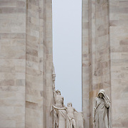 A detail of the center of the twin white pylons  of the ‪Canadian National Vimy Memorial‬ showing the Spirit of Sacrifice,and the Weeping Woman or Mother Canada mourning her dead. The monument is dedicated to the memory of Canadian Expeditionary Force members killed in World War one. The monument is situated at a 100 hectare preserved battlefield with wartime tunnels, trenches, craters and unexploded munitions. The memorial designed by Walter Seymour Allward opened in 1936.