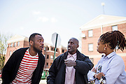 Baltimore, Maryland - April 21, 2015: Craig Washington, left, Cordell Moore, middle and Nicole Hanson, right, talk to reporters after a man was chased down by police through the same West Baltimore public housing walkway Freddie Gray was apprehended. Gray later died from injuries he received while in custody.<br /> <br /> <br /> Hanson works with an outreach program called Out For Justice, who works with ex-offenders. <br /> <br /> CREDIT: Matt Roth for The New York Times<br /> Assignment ID: 30173645A
