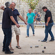 Locals play P&eacute;tanque outside the city walls Sainte Paul De Vence, France. <br /> <br /> By Jack Megaw.<br /> <br /> www.jackmegaw.com<br /> <br /> jack@jackmegaw.com<br /> @jackmegawphoto<br /> [US] +1 610.764.3094<br /> [UK] +44 07481 764811