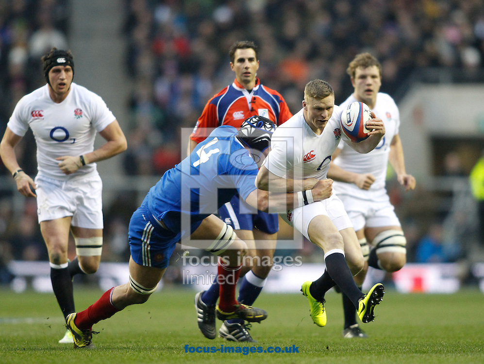 Picture by Andrew Tobin/Focus Images Ltd +44 7710 761829.23/02/2013. Chris Ashton of England is tackled by Christophe Samson of France during the RBS 6 Nations match at Twickenham Stadium, Twickenham.