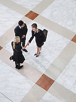 Business people shaking hands elevated view