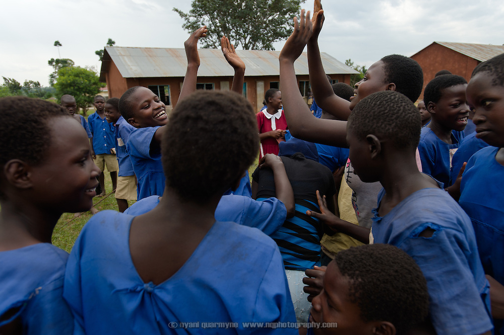 Girls celebrate after winning a tug-of-war at Aputiri Primary School in Eastern Uganda on 31 July 2014. The school participates in a Menstrual Health Management program supported by Plan International, which includes the distribution of reusable sanitary pads made in Uganda by Afripads. Teachers report that absenteeism has fallen sharply, as girls who used rags or cotton wool previously would stay home for fear of leakage and embarrassment. Girls who use Afripads say that they are more comfortable now, and can run and play which they were afraid to do before when they had their periods.