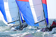 MIAMI - NOVEMBER 11, 2011 - Funner, skippered by Sid Gorham of San Francisco Yacht Club leads Flyer, skippered by Chuck Holtzman of Crescent Sail Yacht Club at the Melges 20 Nationals in Coconut Grove, FL.