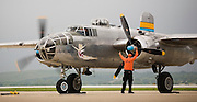 "The pilot and mechanic of the ""Miss Mitchell"" use team work to safely start the B-25J Mitchell bomber from the St.Paul, Minnesota Wing of the Commemorative Air Force (CAF). Three North American B-25 Mitchell bombers of the CAF were viewed by military families at Kelly Field, Lackland Air Force Base, TX on April 20, 2007. After the viewing, the three bombers made a 3-ship formation flyby of the Basic Military Training airmen graduation ceremonies. the aircraft were at Lackland Air Force Base to commemorate the 65th anniversary of the Doolittle air raid of Tokyo, Japan, the surviving airmen were present for a reunion during the week. (Photo copyright 2007 Lance Cheung).."
