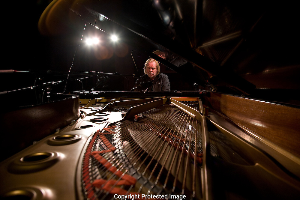 Portrait of Rick Wakeman seated at grand piano, Marlowe Theatre, Canterbury, Kent