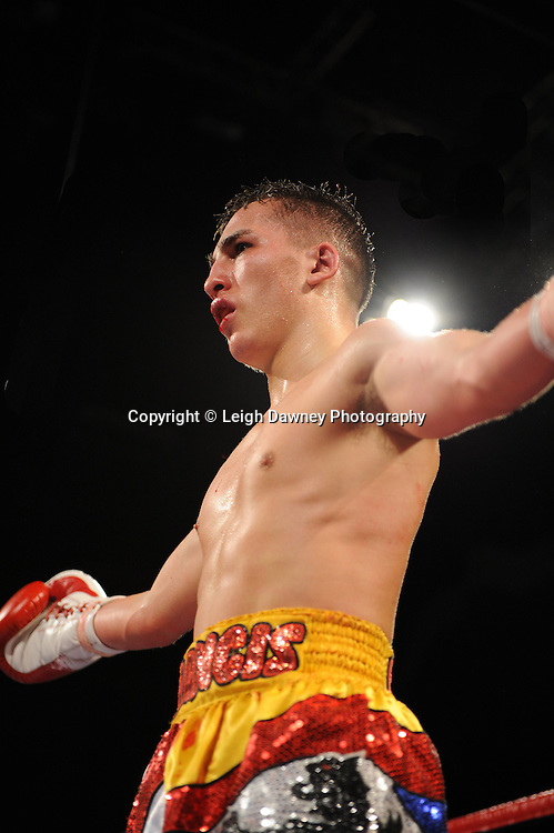 Martin Power (blue shorts) defeats Francis Croes at Brentwood Centre, Brentwood, Essex on the 5th February 2011. Frank Maloney Promotions. Photo credit © Leigh Dawney