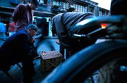 CHINA SHANGHAI NOV01 - Chinese men play mahjong on a downtown Shanghai street.. . jre/Photo by Jiri Rezac. . © Jiri Rezac 2001. . Contact: +44 (0) 7050 110 417. Mobile:  +44 (0) 7801 337 683. Office:  +44 (0) 20 8968 9635. . Email:   jiri@jirirezac.com. Web:     www.jirirezac.com
