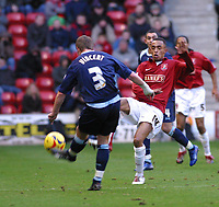 Photo: Dave Linney.<br />Walsall v Swindon Town. Coca Cola League 2. 09/12/2006<br />Walsall's Mark Wright(r) attempts a challenge onJamie Vincent.