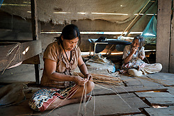 NO WEB/NO APPS - Exclusive. (Text available) Two women are weaving wicker baskets, in 'Palma Real' native community, near Puerto Maldonado, Peru on July 17, 2017 The Amazon rainforest is famous as 'The Lung of the Earth', but also for the presence of numerous native communities, who have always lived isolated and in close contact with nature for generations, used to seek for food and medicines and to build items directly from the environment in which they live. The unstoppable rise of globalization has drastically changed their needs, expectations and consequently their way of life. Located in the Tambopata National Reserve, on the border between Peru and Bolivia, the native Comunidad Palma Real is one of the clearest examples of this change. Living on the banks of the Madre de Dios River since approximately 1976, Palma Real comprises about 300 people part of the nomadic community Ese-Eja, established in the Amazon rainforest of Peru before the Spanish colonization. Photo by Giacomo d'Orlando/ABACAPRESS.COM