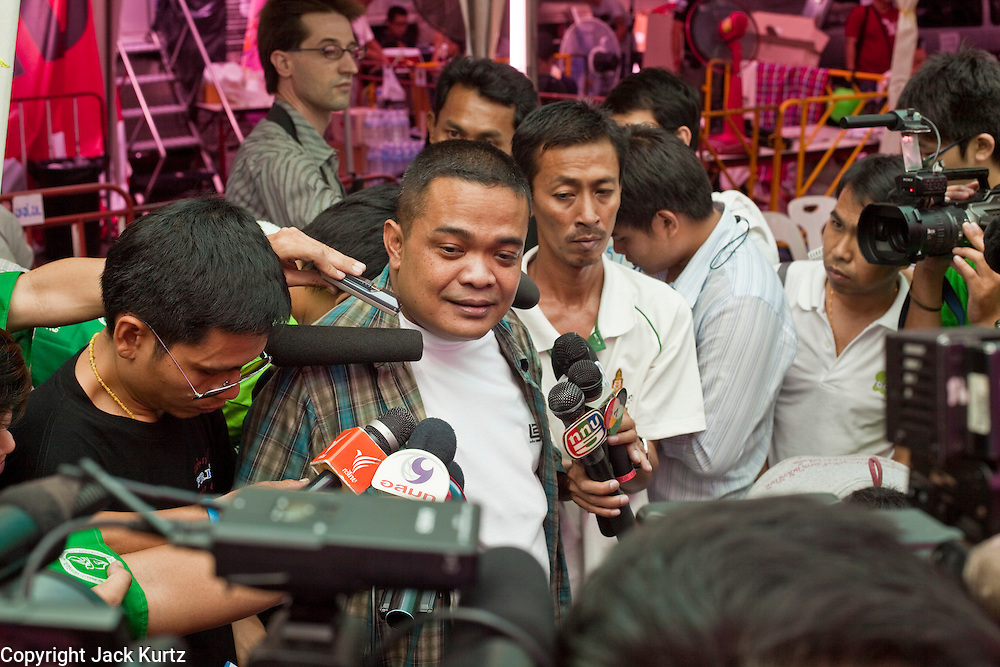 "11 MAY 2010 -- BANGKOK, THAILAND: Jutaporn Prompan, a Red Shirt ""core leader"" talks to reporters in the Red Shirt protest site in Ratchaprasong Intersection. The Red Shirts are continuing their protests in Bangkok and demanding the dissolution of the Thai parliament and resignation of Thai Prime Minister Abhisit Vejjajiva.  PHOTO BY JACK KURTZ"