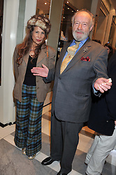 MARTIN JONES and TRUDIE JUGGERNAUTH-SHARMA at a reception to unveil the ISAF World Match Racing Tour Championship Trophy at Garrard, 24 Albemarle Street, London W1 on 7th November 2011.