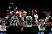 Sian Ruck (facing) celebrates having Poonam Raut caught during the ICC Women's World Twenty20 Cup semi-final between New Zealand and India at Trent Bridge. Photo © Graham Morris (Tel: +44(0)20 8969 4192 Email: sales@cricketpix.com)