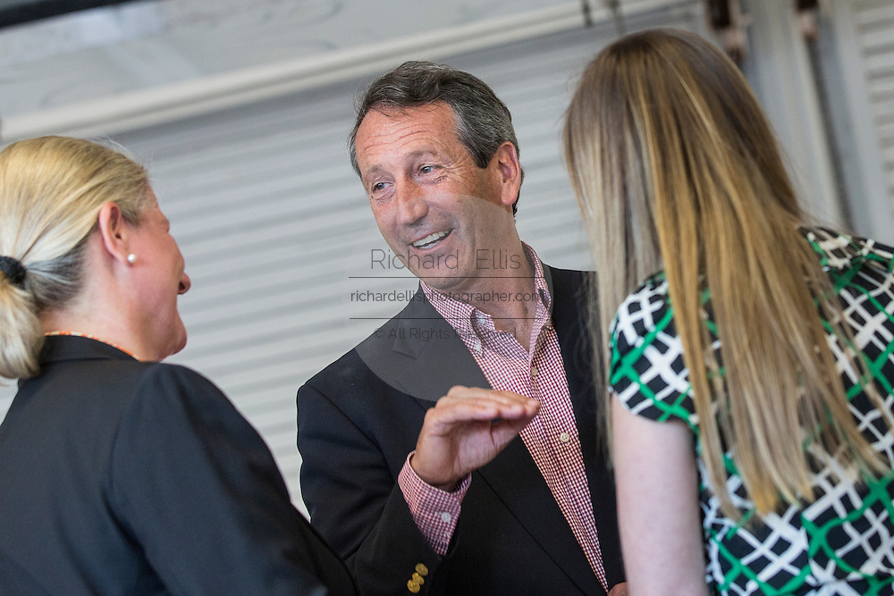 Former Republican Governor Mark Sanford talks with supporters during the Charleston Area Chamber of Commerce's Pork and Politics on April 30, 2013 in Charleston, South Carolina.