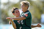 BRISBANE, AUSTRALIA - NOVEMBER 09:  Michelle Heyman (R) celebrates a goal with Ashleigh Sykes of United during the round one W-League match between the Brisbane Roar and Canberra United at AJ Kelly Fields, Kippa Ring on November 9, 2013 in Brisbane, Australia.  (Photo by Matt Roberts/Getty Images)
