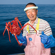 Hasegawa-san with a freshly caught species of deep-sea king crab (Lithodes turritus), known as hari-ibaragani in Japanese. This was caught at a depth of 1000m.