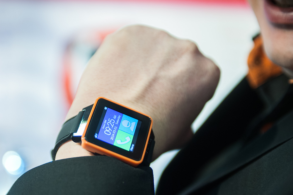 London, UK - 17 March 2014: a man wears a Burg smart watch at the Wearable Technology Conference at Olympia in London