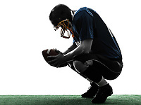one  defeated american football player man in silhouette studio isolated on white background
