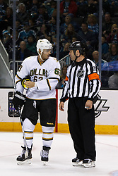 Mar 31, 2012; San Jose, CA, USA; Dallas Stars center Mike Ribeiro (63) talks with NHL referee Justin St. Pierre (12) during the second period against the San Jose Sharks at HP Pavilion. San Jose defeated Dallas 3-0. Mandatory Credit: Jason O. Watson-US PRESSWIRE