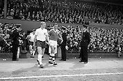 24/05/1964<br /> 05/24/1964<br /> 24 May 1964<br /> Soccer International: Ireland v England at Dalymount Park, Dublin. England won the game 3-1.  Captains Booby Moore (England, left) and Noel Cantwell (Ireland) lead their squads onto the grounds.