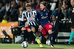(L-R) Reuven Niemeijer of Heracles Almelo, Lasse Schone of Ajax during the Dutch Eredivisie match between Heracles Almelo and Ajax Amsterdam at Polman stadium on August 12, 2017 in Almelo, The Netherlands