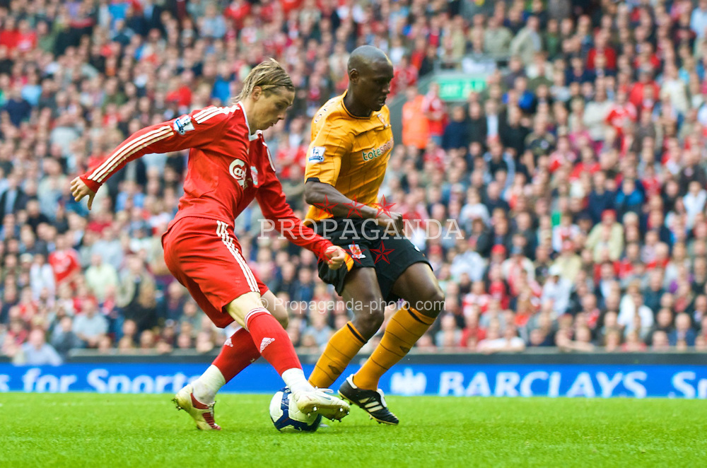 LIVERPOOL, ENGLAND - Saturday, September 26, 2009: Liverpool's Fernando Torres turns Hull City's Ibrahima Sonko on his way to scoring his hat-tick goal to make it 3-0 against Hull City during the Premiership match at Anfield. (Photo by: David Rawcliffe/Propaganda)