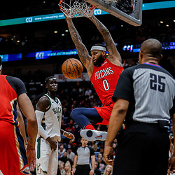 Dec 13, 2017; New Orleans, LA, USA; New Orleans Pelicans center DeMarcus Cousins (0) dunks against the Milwaukee Bucks during the fourth quarter at the Smoothie King Center. The Pelicans defeated the Bucks 115-108. Mandatory Credit: Derick E. Hingle-USA TODAY Sports