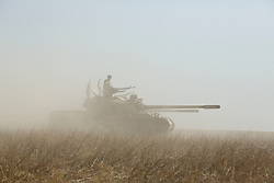 20/10/2016. Bashiqa, Iraq. Smoke obscures a Kurdish T-55 tank after firing at ISIS held positions as peshmerga fighters start a large offensive to retake the Bashiqa area from Islamic State militants today (20/10/2016).<br /> <br /> Launched in the early hours of today with support from coalition special forces and air strikes, the attack is part of the larger operation to retake Mosul from the Islamic State, and involves both the Kurds and the Iraqi Army. The city of Bashiqa, around 9 miles north of Mosul, is one of several gateway areas that must be taken before any attempted offensive on Mosul itself.<br /> <br /> Despite the peshmerga suffering several casualties after militants fought back using mortars, heavy machine guns and snipers, the Kurdish forces were quickly taking ground with Haider al-Abadi, the Iraqi prime minister, stating that the operation to retake Mosul was progressing faster than expected. Photo credit: Matt Cetti-Roberts/LNP