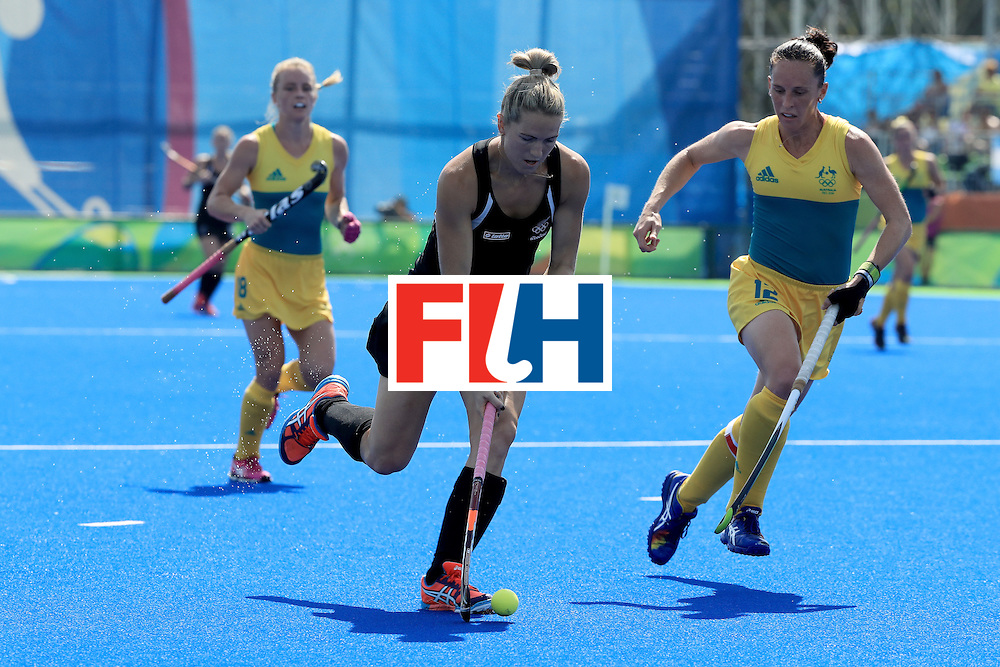 RIO DE JANEIRO, BRAZIL - AUGUST 15:  Stacey Michelsen #31 of New Zealand runs past Madonna Blyth #12 of Australia during a quarterfinal match at Olympic Hockey Centre on August 15, 2016 in Rio de Janeiro, Brazil.  (Photo by Sam Greenwood/Getty Images)