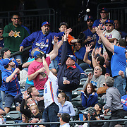 NEW YORK, NEW YORK - May 22:  Fans reach for a foul ball during the Milwaukee Brewers Vs New York Mets regular season MLB game at Citi Field on May 22 2016 in New York City. (Photo by Tim Clayton/Corbis via Getty Images)