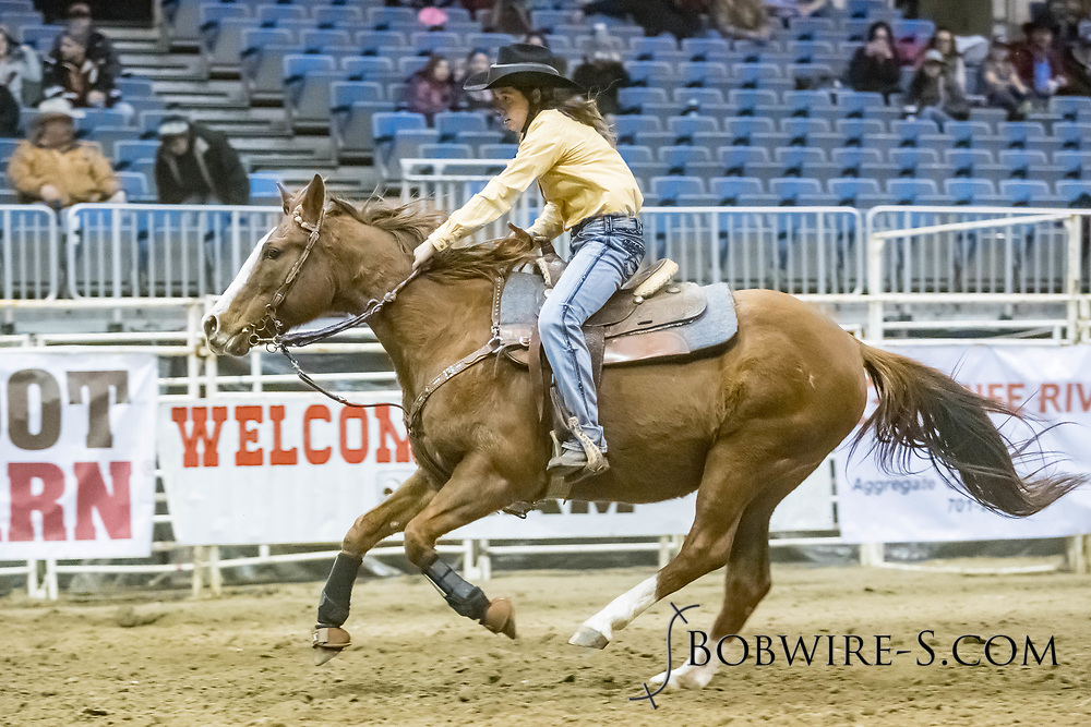 Barrel racer Margaret Schmitke makes her run during slack at the Bismarck Rodeo on Saturday, Feb. 3, 2018. She had a time of 16.01 seconds. This photo and more from most runs are available at Bobwire-S.com.