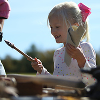 Lucy Kent, 5, happily inspects a Native American tool Saturday at the Ingomar Mound event