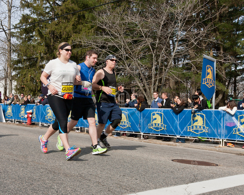 2013 Boston Marathon: visually impaired athlete with guides start
