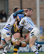 Wycombe, GREAT BRITAIN, Wasps, Simon SHAW, tackled by left, Peter SHORT and Shaun BERNE, during the Guinness Premiership game London Wasps v Bath Rugby, at Adams Park, Bucks  29/12/2007 [Mandatory Credit Peter Spurrier/Intersport Images]