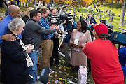 "Rochester Mayor Lovely Warren speaks with the media after placing her ""I Voted"" sticker on headstone of Susan B. Anthony, the social reformer who played a key part in the movement for women's suffrage, at Mount Hope Cemetery in Rochester on Tuesday, November 8, 2016. Warren is Rochester's first female mayor."