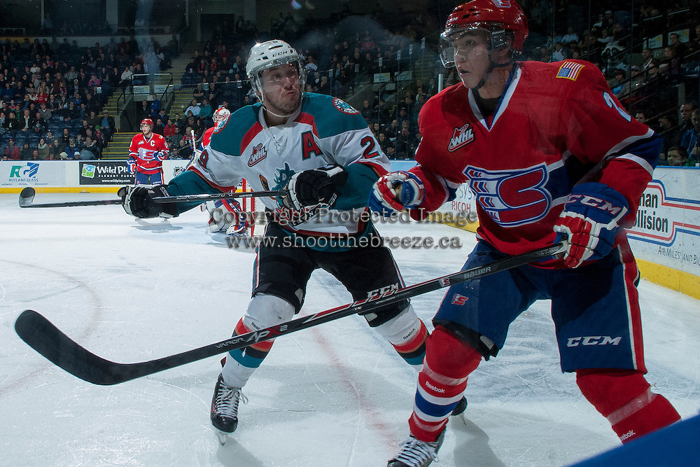 KELOWNA, CANADA -JANUARY 29: Myles Bell #29 of the Kelowna Rockets checks Jason Fram D #2 of the Spokane Chiefs during the third period on January 29, 2014 at Prospera Place in Kelowna, British Columbia, Canada.   (Photo by Marissa Baecker/Getty Images)  *** Local Caption *** Myles Bell; Jason Fram;