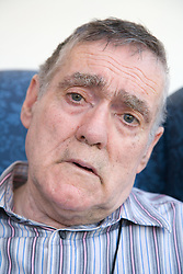 Portrait of a man with Alzheimer's Disease looking worried,