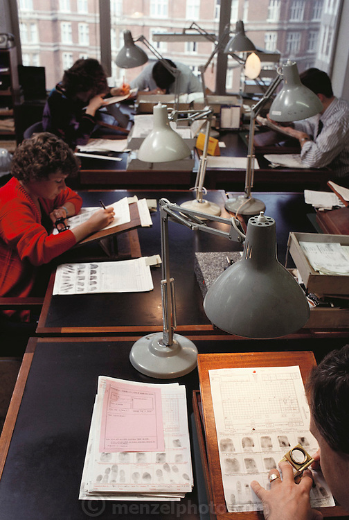 (1992) Coding fingerprints by hand in preparation to enter the information in a computer system. Scotland Yard, London, England. DNA Fingerprinting.