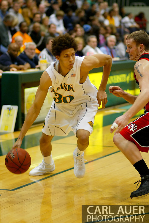 1/13/2006: Sophomore forward Cameron Burney (30) of the UAA Seawolves in the Alaska Anchorage comeback victory over Northwest Nazarene, 60-57, in men?s basketball action at the Wells Fargo Sports Complex on Saturday.