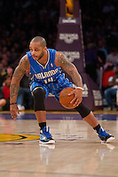 02 December 2012: Guard (14) Jameer Nelson of the Orlando Magic dribbles the ball against the Los Angeles Lakers during the first half of the Magic's 113-103 victory over the Lakers at the STAPLES Center in Los Angeles, CA.